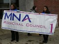 MNA banner holders are: MNA member Patty Healey & Region1 staff Heather LaPenn