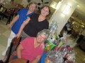 Holy Family Committee members with the raffle baskets